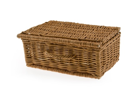 An empty wicker basket isolated on a white background.