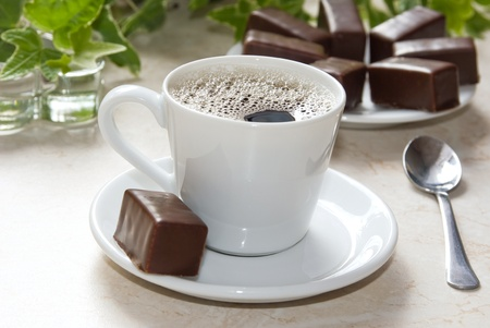 Americano cup of coffee, and delicious chocolates