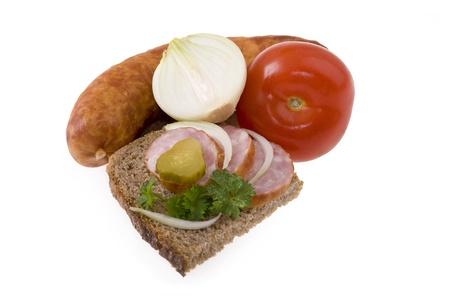 Fresh pork sausage with bread, cucumber, onion,tomato Zdjęcie Seryjne - 9664941