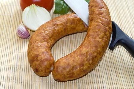 Fresh sausage, tomato, onion and garlic Zdjęcie Seryjne - 9664944