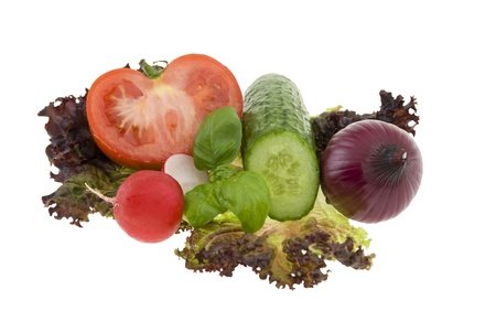 Chopped fresh vegetables on white background