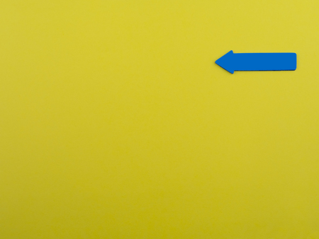 Yellow background with blue arrow sign up and copyspace for text