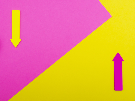 Yellow and pink background with arrows and copyspace for text