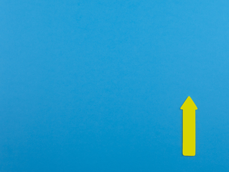 Blue background with yellow arrow sign up and copy space for text