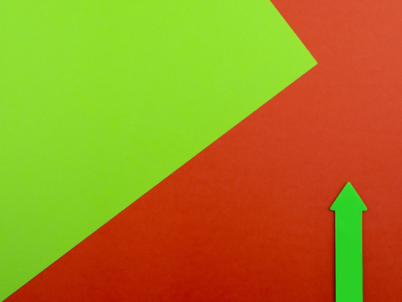 Red and green background with green arrow and copyspace for text
