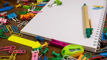 Office supplies on brown wooden table background. Back to school concept