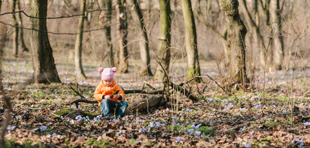 flourished: little girl learns nature. springtime.