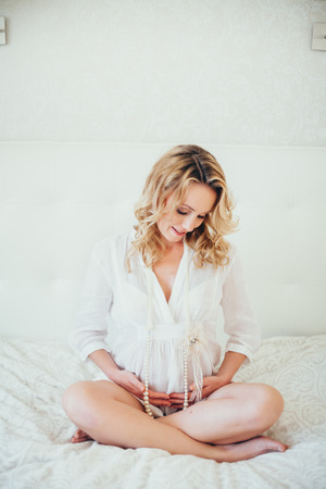 enceinte: a happy  pregnant woman.interior.
