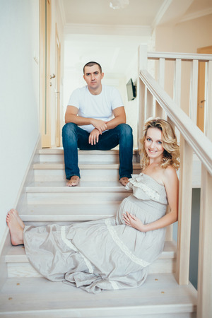 impregnated: a happy  pregnant woman with husband. interior. Stock Photo