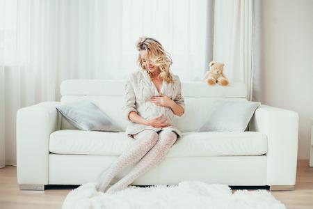 enceinte: a happy  pregnant woman in  interior.