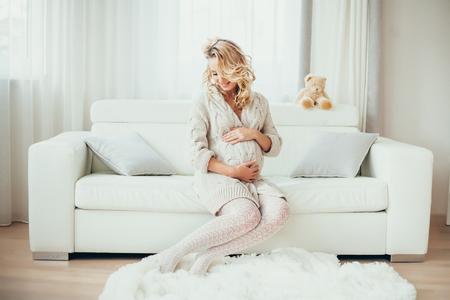 a happy  pregnant woman in  interior.