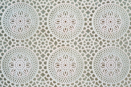 Lace is an openwork fabric, patterned with open holes in the work, made by machine or by hand. photo
