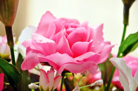 Artificial flowers are imitations of natural flowering plants, used for commercial or residential decoration. photo