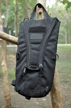 The Camelback hydration system or camel bag is backpack containing drinking water. photo
