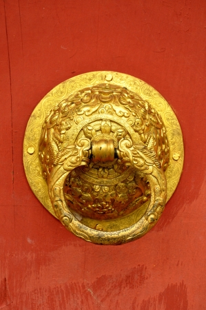 golden door handle. Installed on the doors of art in China. photo