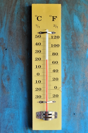 A thermometer is a device that measures temperature or temperature gradient using a variety of different principles  Stock Photo