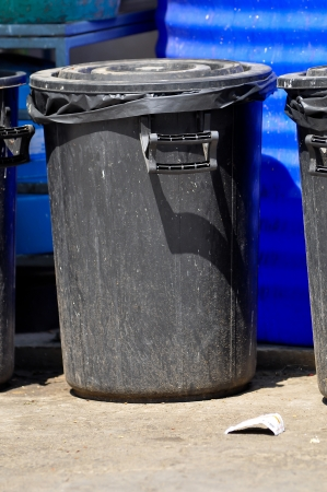 A waste container is a container for temporarily storing refuse and waste. photo
