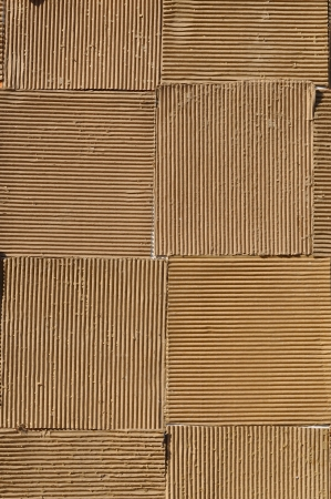Corrugated fiberboard is a paper-based material consisting of a fluted corrugated sheet and one or two flat linerboards. photo