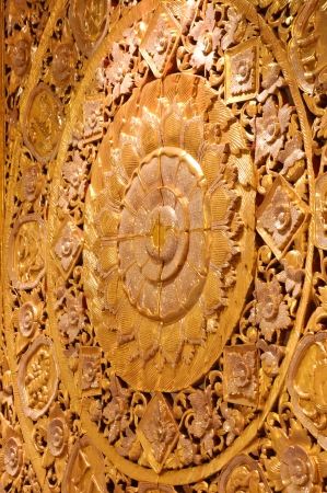Wall wood carved golden lotus bloom  Used to decorate the hall  photo