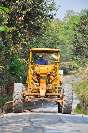 Graders are commonly used in the construction and maintenance of dirt roads and gravel roads Stock Photo - 20937028