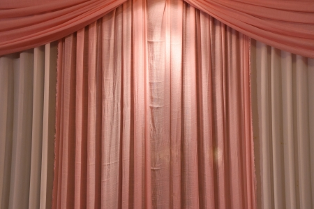 Pink curtains were hung up for beautiful scene  photo
