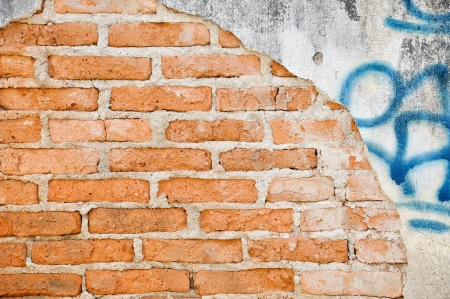 background of brick wall with crack and graffiti photo