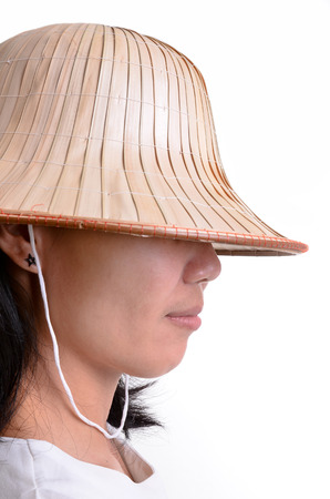 Girl with the conical Asian hat on white background  photo