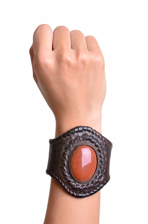 Leather bracelet adorned with colored stones. Stock Photo