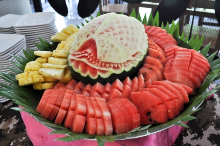 Watermelon carving on food sets photo