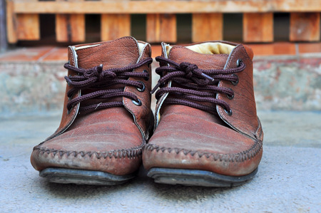 Brown leather shoes with laces were put aside. photo