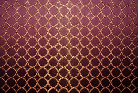 upholster: Gold thread embroidered circles on a purple background.