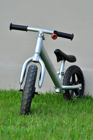 Balance bicycle is a toy that gives kids practice in the skills of balance and judgment. photo