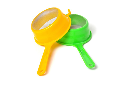 Yellow and Green handle colander isolated on white background photo