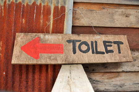 Signs to the toilets, which was written on a sheet of plywood. photo
