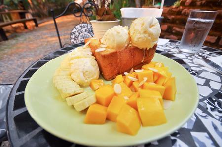 Honey toast with banana and mango. photo