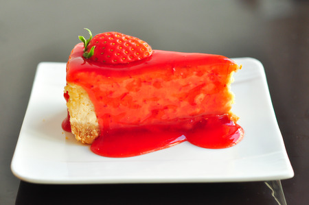 Strawberry cheesecake with fresh strawberry in tea times photo