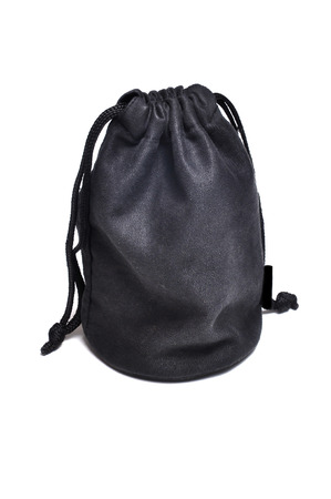 Black suede bag isolated on white background. photo