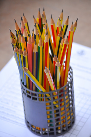 desk tidy: a many harpen pencil in the basket