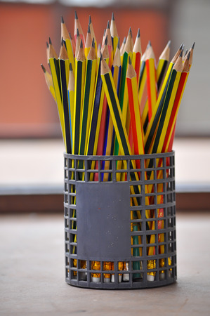 a many harpen pencil in the basket photo