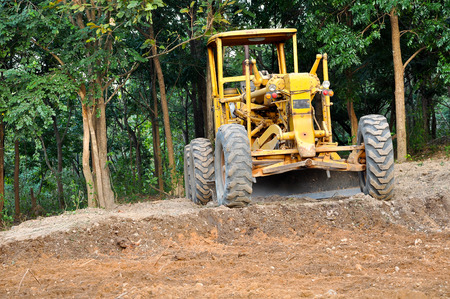 gravel roads: Graders are commonly used in the construction and maintenance of dirt roads and gravel roads. Stock Photo