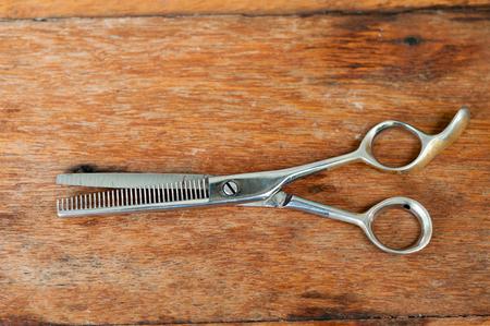 Barber scissors  on wooden table