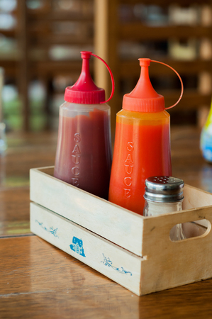 dipping: Ketchup and chilli sauce in small wooden box Stock Photo