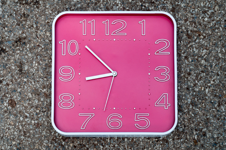 oclock: The pink clock indicates the time before nine oclock as the start of the work.
