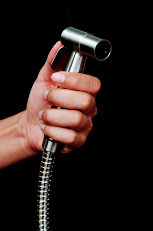 bidet: bidet shower in hand  isolated on black background