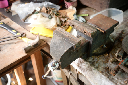 bench vise on the table with the other hardware equipment