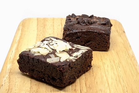 chocolate chip and almond brownies on wood plate