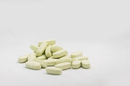 Medical light green pills isolated Stock Photo