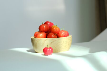 organic acerola cherry in wooden blow