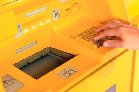 Withdraw money from an automated teller machine