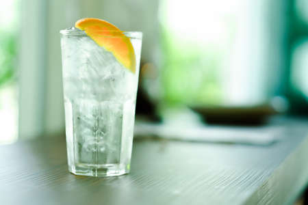 Refreshing water with ice and orange